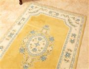 Sale 9071H - Lot 13 - A Chinese floor rug with powder blue floral medallion on a yellow ground, 180cm x 120cm
