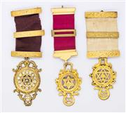 Sale 8265 - Lot 320 - THREE STERLING SILVER GILT MASONIC BREAST JEWELLS BY BLASHKI; each with 3 bars and a symbolic pendants.