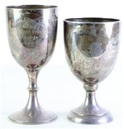 Sale 8972 - Lot 41 - A Matched Pair Of Sterling Silver Horse Racing Trophies (H: 20cm & 18cm) (Cmb Wt 500g) Some Dents And Tarnish