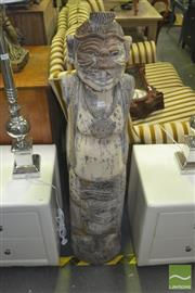 Sale 8331 - Lot 1034 - Very large Indonesian tribal figure carved from a log in one piece  c.1950