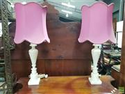 Sale 8617 - Lot 1003 - Pair of Turned Alabaster Table Lamps, of baluster form, with pink fabric shades