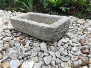 Sale 8706A - Lot 50 - An 18th century carved stone water trough / planter general wear, H 15 x L 53cm