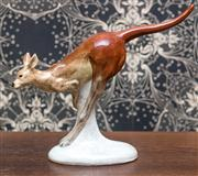 Sale 8222 - Lot 97 - A ceramic figure of a kangaroo, H 30, W 37cm, mark to base with Australia Sticker