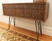 Sale 8863H - Lot 72 - An apothecary mid-century style console with aged metal accent handles, and hairpin legs. Each drawer is three handles wide, some be...