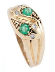 Sale 9012 - Lot 372 - AN EMERALD AND DIAMOND SERPENT RING; 9ct gold entwined snakes with round brilliant cut diamond set eyes and 2 round cut emeralds to...