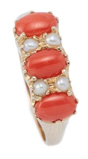 Sale 9029 - Lot 351 - A VICTORIAN STYLE CORAL AND PEARL RING; belcher set in 9ct gold with 3 cabochon corals and 4 seed pearls, size N-O, wt. 2.63g.