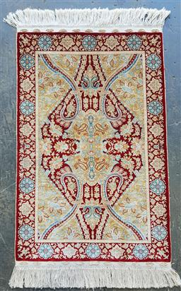 Sale 9179 - Lot 1061A - Small Turkish Kayseri Silk Carpet, with unusual floral pattern, in red, cream & blue tones, with small raised panels to fringe inclu...