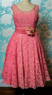 Sale 8420A - Lot 23 - A 1950s pink lace party/prom dress featuring boned bodice, metal zipper at the back, full swing pink lace skirt and sash with handm...