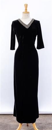 Sale 8891F - Lot 66 - A black velour full-length tunic dress with beaded neckline, approx size 8/10