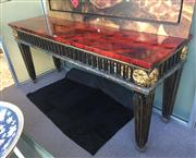 Sale 8205 - Lot 45 - A magnificent contemporary carved and ebonised console table, with leopard fur arcade, a red lacquered walnut effect top, with gilt...