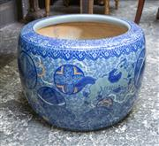 Sale 8746 - Lot 1001 - A large Arita export porcelain jardinière, in underglaze blue with a band of lambrequin and shishi, amongst round patterned reserves...