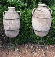 Sale 8950G - Lot 71 - Fine pair of Antique 18th century Greek olive jars on later stand Right side jar is 1.27m Height Left side jar 1.17m Height