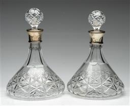 Sale 9211 - Lot 82 - A Pair of Cut Glass Ship Decanters With Silver Collars (H:30cm)
