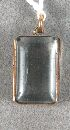 Sale 3682 - Lot 641 - A RECTANGULAR GLASS LOCKET SET IN A 9CT GOLD FRAME.