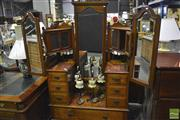 Sale 8341 - Lot 1005 - Timber Mirrored Back Dresser with Winged Mirrors, Four Glass Panel Doors & Seven Drawers