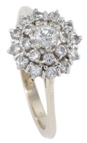 Sale 8965 - Lot 387 - AN 18CT GOLD DIAMOND CLUSTER RING; centring a round brilliant cut diamond of approx. 0.10ct to double surround of a further 20 brill...