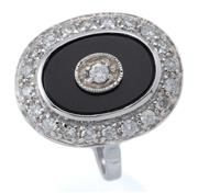 Sale 9029 - Lot 386 - A 9CT WHITE GOLD DECO STYLE DIMOND AND ONYX RING; 20 x 16mm oval mount centring a round brilliant cut diamond within an onyx surroun...