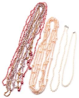 Sale 9145 - Lot 353 - FOUR FRESHWATER CULTURED PEARL NECKLACES; 2 single strands of 4.8mm off round pearls to silver clasps, lengths 38 & 45cm, a long rop...