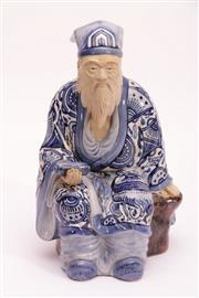 Sale 9015C - Lot 750 - Blue and white ceramic figure of a seated elder (H32cm)