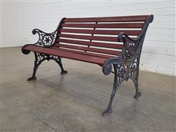 Sale 9151 - Lot 1449 - Timber garden bench with wrought iron ends (h:74 w:119 d:58cm)
