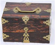 Sale 8319 - Lot 215 - Medium size coromandel box with intricate brass strappings and handle