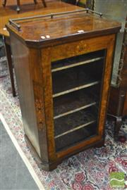 Sale 8359 - Lot 1065 - A Victorian Inlaid Figured Walnut Music Cabinet with brass gallery and glass panel door.