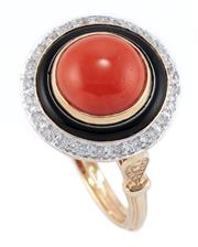 Sale 8937 - Lot 461 - A DECO STYLE CORAL DIAMOND AND ONYX RING; 9mm round cabochon coral to a circle of onyx and a surround of round brilliant cut diamond...