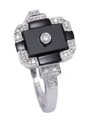 Sale 9012 - Lot 392 - A DECO STYLE DIAMOND AND ONYX RING; 9ct white gold geometric top and shoulders set with onyx plaques and round brilliant cut diamond...