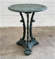 Sale 9085 - Lot 1051 - Victorian Style Cast Iron Occasional Garden Table, painted green, the round pierced leaf form top on scroll supports & triform plint...