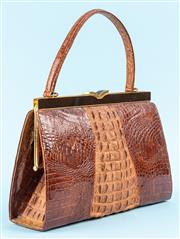 Sale 9090J - Lot 335 - A VINTAGE CROCODILE HANDBAG; with dark brown leather lining with two large slip pockets and one zip compartment, dark brown enamelle...