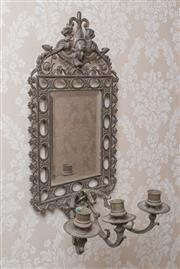 Sale 8375A - Lot 112 - A metal framed candle wall sconce with mirrored back, H 48cm