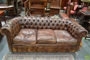 Sale 8460 - Lot 1043 - Good Pair of Three Seater Brown Buttoned Leather Chesterfield Lounges, with studded details