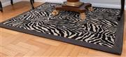 Sale 8562A - Lot 19 - DOWNSTAIRS OFFICE - A small zebra motif woven woollen rug with black boarder, 150 x 115cm