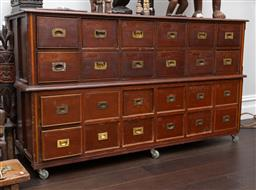 Sale 9160H - Lot 71 - A vintage pine and brass chest of 24 drawers, with later castors, Height 93cm x Width 164cm x Depth 52cm