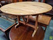 Sale 8485 - Lot 1070 - Antique French Cherry & Oak  Wine Table, with round folding top, on swivel support (H 69 x D 108cm)