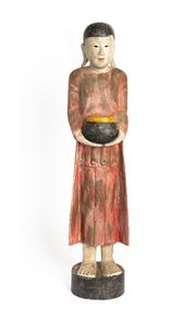 Sale 8844 - Lot 71 - A Thai carved timber and polychrome figure of a monk holding an urn. Height 88cm.