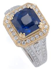 Sale 9083 - Lot 423 - A 14CT TWO TONE GOLD SAPPHIRE AND DIAMOND RING; centring a square emerald cut blue sapphire of approx. 3.6ct, in yellow gold setting...