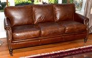 Sale 8088A - Lot 21 - A Winchester three seater in leather; width 180cm