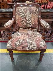 Sale 8782 - Lot 1389 - Victorian Oak Armchair, the back, arms & seat upholstered in an animal patch-work print, raised on turned legs