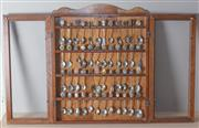Sale 8375A - Lot 115 - A timber glass fronted display cabinet, H 60cm together with souvenir teaspoons