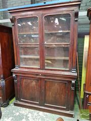 Sale 8539 - Lot 1030 - Mid-19th Century Mahogany Veneered Bookcase, with two veneered astragal doors & fully adjustable shelves, flanked by pilasters & cor...