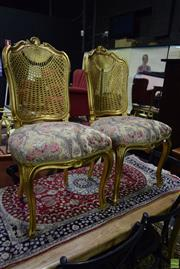 Sale 8566 - Lot 1742 - Pair of Gilt Dining Chairs with Rattan Back