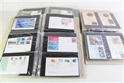Sale 8944 - Lot 94 - 4 Binders First Day Covers incl. some with Dollar & Fifty Cent Coins Plus Medallions