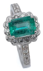 Sale 9083 - Lot 452 - AN 18CT WHITE GOLD EMERALD AND DIAMOND RING; centring an emerald cut emerald of approx. 1.15ct to surround and shoulders set with a...