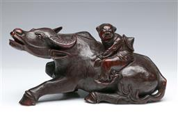 Sale 9098 - Lot 69 - A large Carved Rosewood Figure Depicting A Boy With Ox L:32cm H:15cm