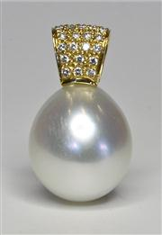 Sale 8036A - Lot 340 - A SOUTH SEA PEARL AND DIAMOND PENDANT; featuring a 13 x 15mm drop shape cultured pearl of fine colour and lustre on an 18ct gold bal...
