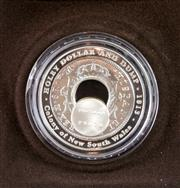 Sale 8299C - Lot 504 - ROYAL AUSTRALIAN MINT HOLEY DOLLAR AND DUMP 2003 FINE SILVER PROOF COIN; denomination $1, wt. 54.3g, in box and case of issue.
