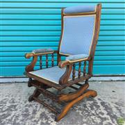 Sale 8649R - Lot 186 - Antique Blue Upholstered Timber Framed Rocking Chair with Column Form Supports to each Armrest (missing front castors, upholstery re...