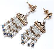 Sale 9029 - Lot 352 - A PAIR OF ANTIQUE STYLE SAPPHIRE AND PEARL FRINGE EARRINGS; featuring a square cut blue sapphire in a scroll surround suspending a f...
