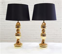 Sale 9126 - Lot 1196 - Pair of Gold Glass Baluster Lamps, with black shades (H: 75 cm)